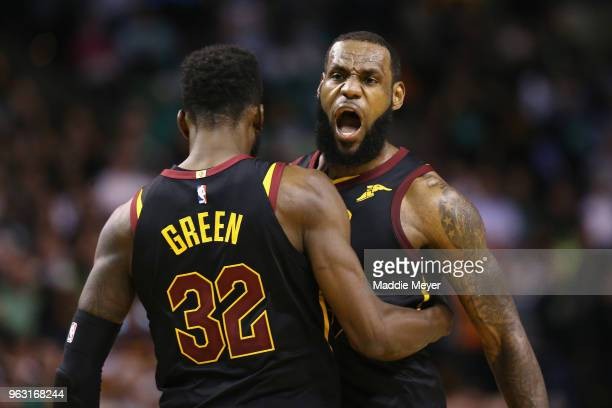 LeBron James of the Cleveland Cavaliers celebrates with Jeff Green in the second half against the Boston Celtics during Game Seven of the 2018 NBA...