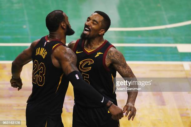 LeBron James of the Cleveland Cavaliers celebrates with JR Smith in the second half against the Boston Celtics during Game Seven of the 2018 NBA...