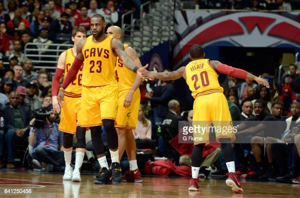 LeBron James of the Cleveland Cavaliers celebrates with Kay Felder during the game against the Washington Wizards at Verizon Center on February 6...