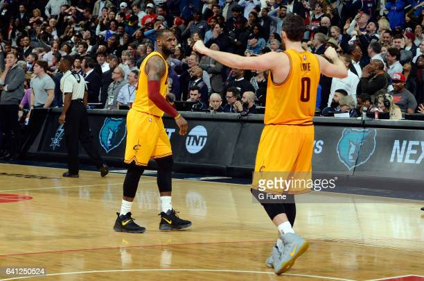 LeBron James of the Cleveland Cavaliers celebrates with Kevin Love after hitting a three point shot to force overtime against the Washington Wizards...