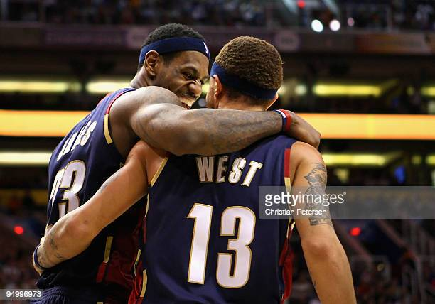 LeBron James of the Cleveland Cavaliers celebrates with teammate Delonte West after a three point play against the Phoenix Suns during the NBA game...