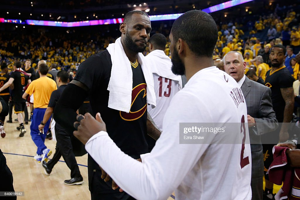 LeBron James #23 of the Cleveland Cavaliers celebrates with teammate Kyrie Irving #2 after defeating the Golden State Warriors in Game 5 of the 2016 NBA Finals with a score of 112 to 97 at ORACLE Arena on June 13, 2016 in Oakland, California.