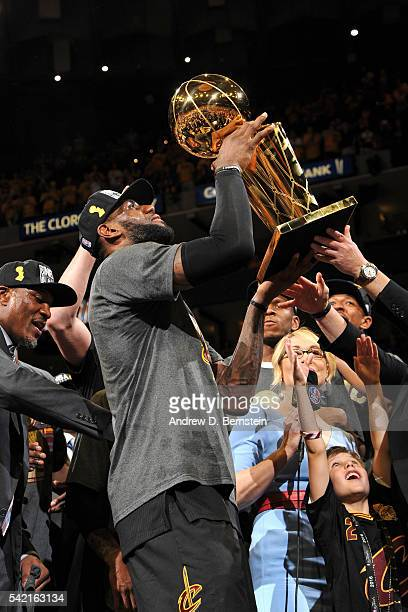 LeBron James of the Cleveland Cavaliers celebrates with the Larry O'Brien NBA Championship Trophy after winning Game Seven of the 2016 NBA Finals...