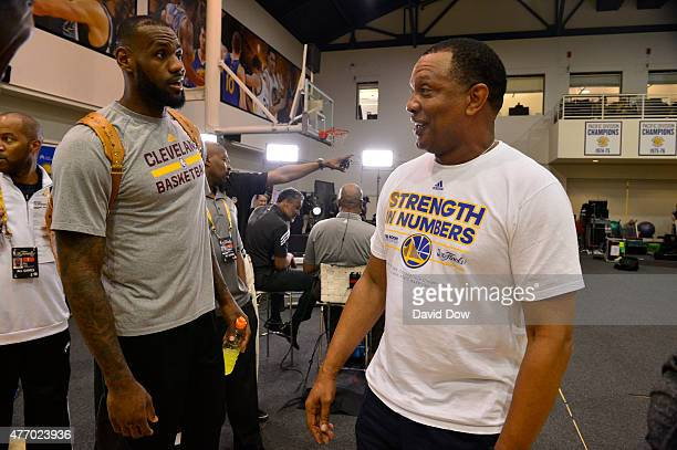 LeBron James of the Cleveland Cavaliers chats with Assistant Coach Alvin Gentry during media availability as part of the 2015 NBA Finals on June 13...