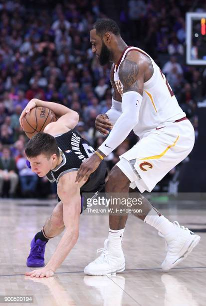 LeBron James of the Cleveland Cavaliers closely guards Bogdan Bogdanovic of the Sacramento Kings during their NBA basketball game at Golden 1 Center...