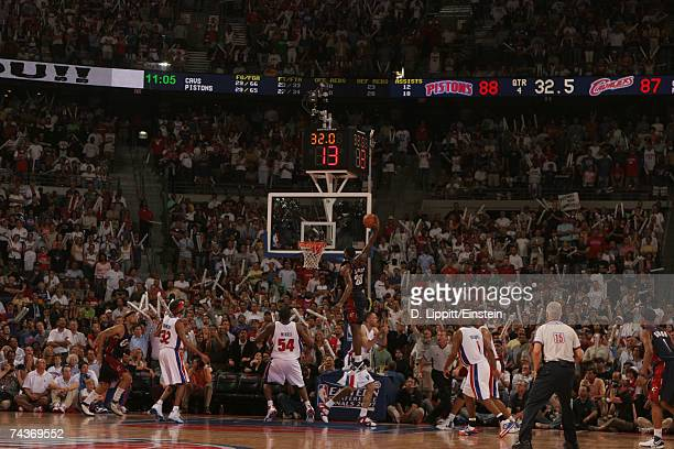 LeBron James of the Cleveland Cavaliers comes in with a big dunk over Tayshaun Prince of the Detroit Pistons in Game Five of the Eastern Conference...