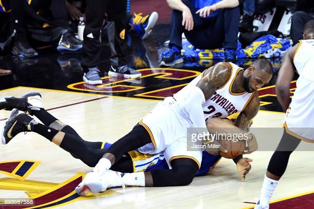 LeBron James of the Cleveland Cavaliers competes for the ball with JaVale McGee of the Golden State Warriors in the first half in Game 3 of the 2017...