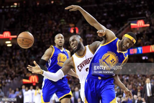 LeBron James of the Cleveland Cavaliers competes for the ball with Ian Clark of the Golden State Warriors in the second half in Game 3 of the 2017...
