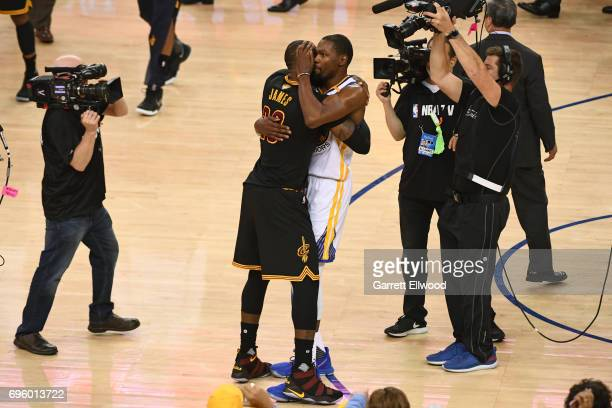 LeBron James of the Cleveland Cavaliers congratulates Kevin Durant of the Golden State Warriors in Game Five of the 2017 NBA Finals on June 12 2017...