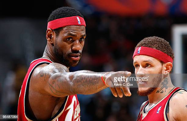 LeBron James of the Cleveland Cavaliers converses with Delonte West against the Atlanta Hawks at Philips Arena on December 29 2009 in Atlanta Georgia...