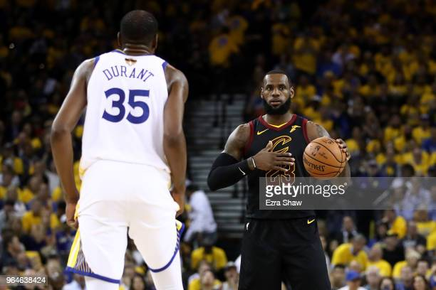 LeBron James of the Cleveland Cavaliers defended by Kevin Durant of the Golden State Warriors during the first half in Game 1 of the 2018 NBA Finals...