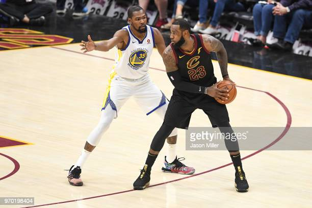 LeBron James of the Cleveland Cavaliers defended by Kevin Durant of the Golden State Warriors during Game Four of the 2018 NBA Finals at Quicken...