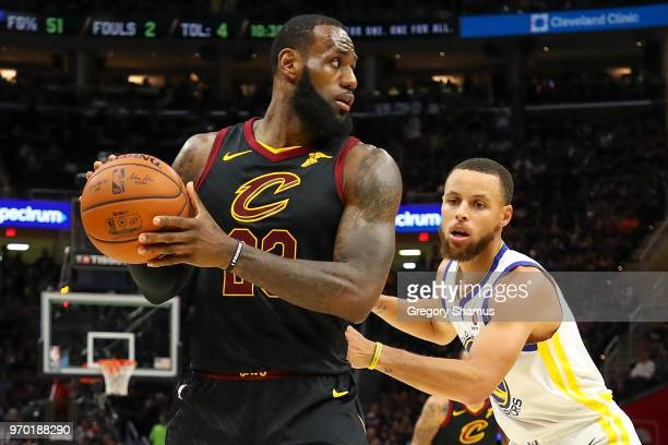 LeBron James of the Cleveland Cavaliers defended by Stephen Curry of the Golden State Warriors during Game Four of the 2018 NBA Finals at Quicken...