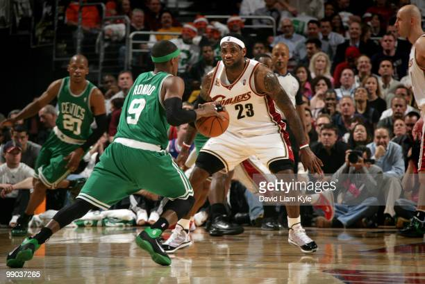 LeBron James of the Cleveland Cavaliers defends a driving Rajon Rondo of the Boston Celtics in Game Five of the Eastern Conference Semifinals during...