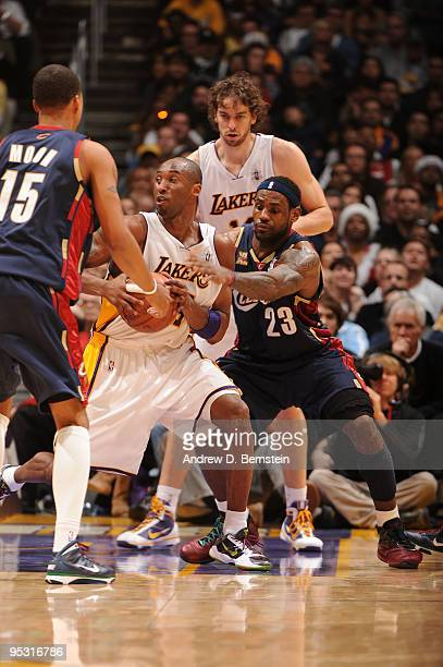 LeBron James of the Cleveland Cavaliers defends against Kobe Bryant of the Los Angeles Lakers at Staples Center on December 25 2009 in Los Angeles...