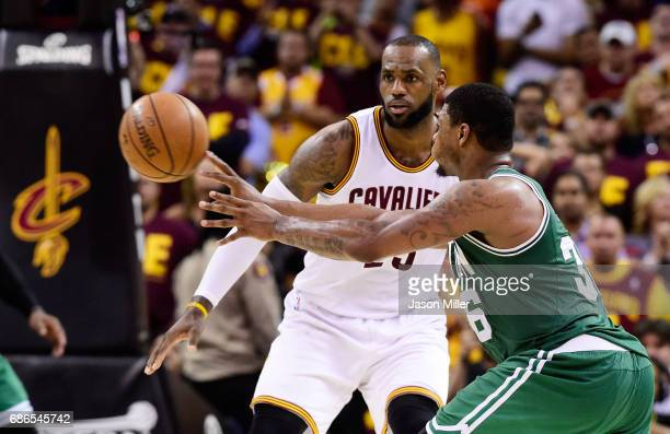 LeBron James of the Cleveland Cavaliers defends against Marcus Smart of the Boston Celtics in the second half during Game Three of the 2017 NBA...