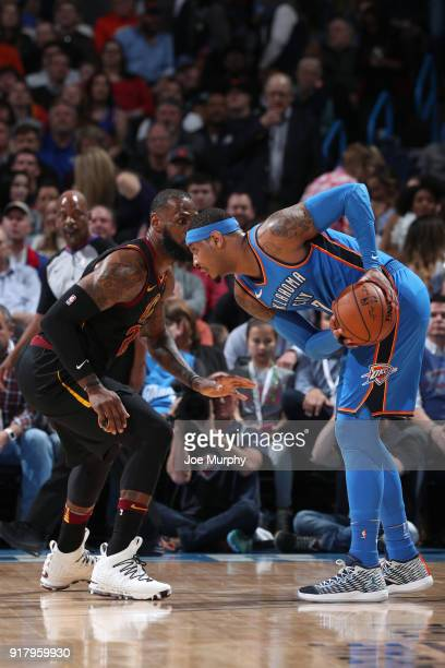 LeBron James of the Cleveland Cavaliers defends Carmelo Anthony of the Oklahoma City Thunder during the game on February 13 2018 at Chesapeake Energy...