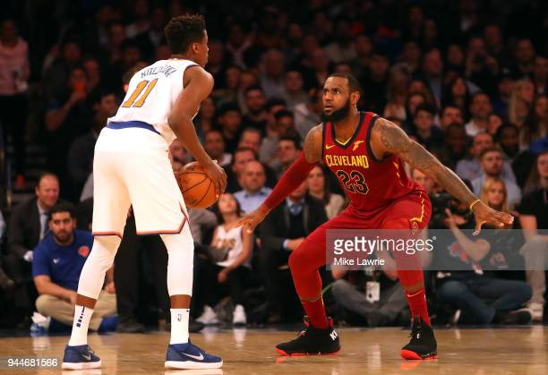 LeBron James of the Cleveland Cavaliers defends Frank Ntilikina of the New York Knicks in the first half at Madison Square Garden on April 9 2018 in...