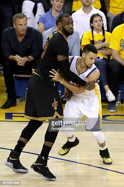LeBron James of the Cleveland Cavaliers defends Stephen Curry of the Golden State Warriors in Game 7 of the 2016 NBA Finals at ORACLE Arena on June...