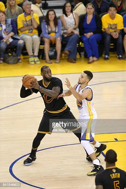 LeBron James of the Cleveland Cavaliers defends the ball against Stephen Curry of the Golden State Warriors during Game Seven of the 2016 NBA Finals...