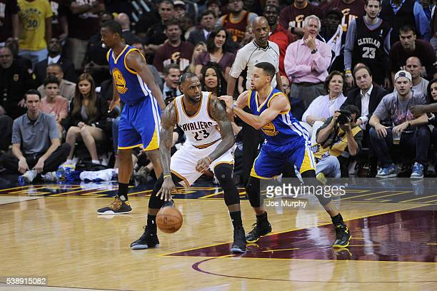 LeBron James of the Cleveland Cavaliers defends the ball basket against Stephen Curry of the Golden State Warriors during Game Three of the 2016 NBA...