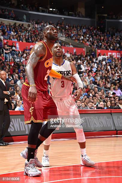LeBron James of the Cleveland Cavaliers defends the basket against Chris Paul of the Los Angeles Clippers during the game on March 13 2016 at STAPLES...