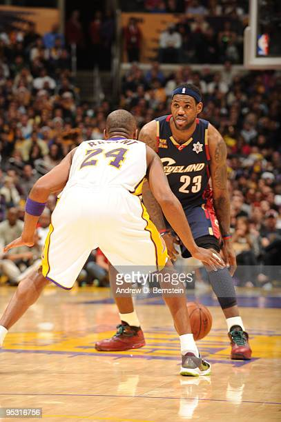 LeBron James of the Cleveland Cavaliers dribbles against Kobe Bryant of the Los Angeles Lakers at Staples Center on December 25 2009 in Los Angeles...
