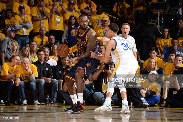 LeBron James of the Cleveland Cavaliers dribbles the ball against Stephen Curry of the Golden State Warriors during Game Five of the 2015 NBA Finals...
