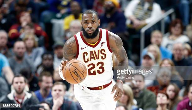 LeBron James of the Cleveland Cavaliers dribbles the ball against the Indiana Pacers at Bankers Life Fieldhouse on December 8 2017 in Indianapolis...