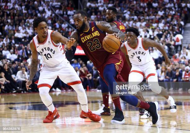 LeBron James of the Cleveland Cavaliers dribbles the ball as DeMar DeRozan of the Toronto Raptors defends in the second half of Game Two of the...