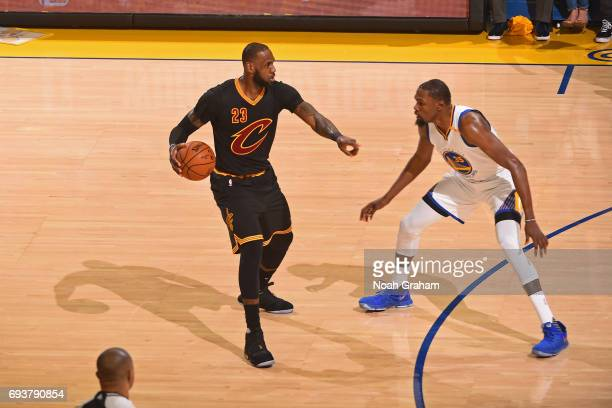 LeBron James of the Cleveland Cavaliers dribbles the ball while guarded by Kevin Durant of the Golden State Warriors in Game Two of the 2017 NBA...