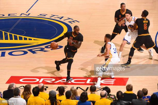 LeBron James of the Cleveland Cavaliers dribbles the ball while guarded by Stephen Curry of the Golden State Warriors in Game Two of the 2017 NBA...