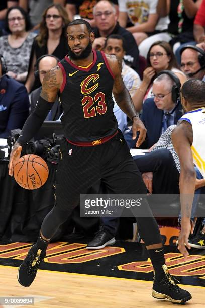 LeBron James of the Cleveland Cavaliers dribbles with the ball against the Golden State Warriors during Game Four of the 2018 NBA Finals at Quicken...