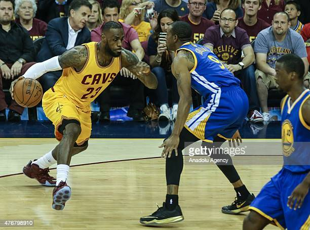 LeBron James of the Cleveland Cavaliers drives against Andre Iguodala of the Golden State Warriors during Game Four of the 2015 NBA Finals between...