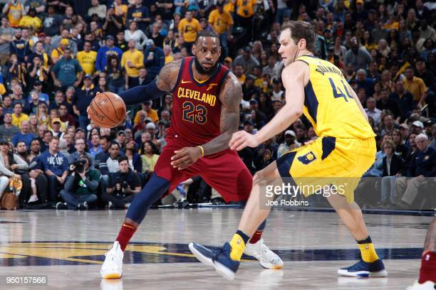 LeBron James of the Cleveland Cavaliers drives against Bojan Bogdanovic of the Indiana Pacers in the second half of game four of the NBA Playoffs at...