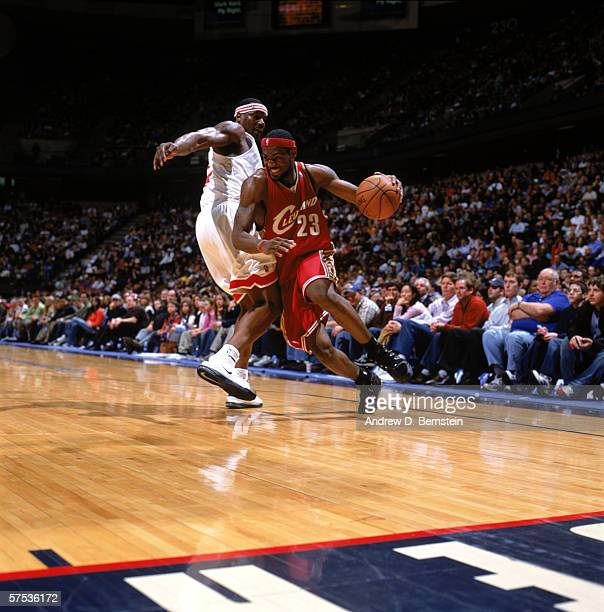 LeBron James of the Cleveland Cavaliers drives against Clifford Robinson of the New Jersey Nets during a game at Continental Airlines Arena on April...