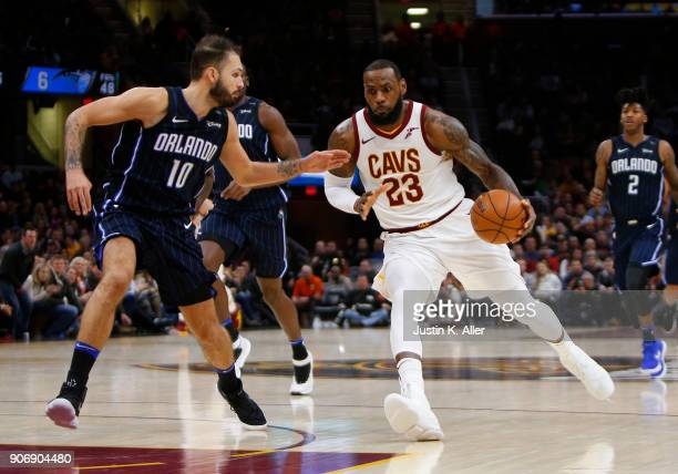 LeBron James of the Cleveland Cavaliers drives against Evan Fournier of the Orlando Magic at Quicken Loans Arena on January 18 2018 in Cleveland Ohio...