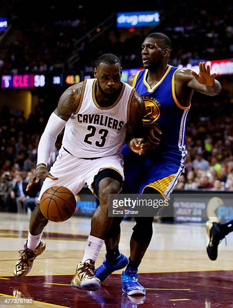 LeBron James of the Cleveland Cavaliers drives against Festus Ezeli of the Golden State Warriors in the third quarter during Game Six of the 2015 NBA...