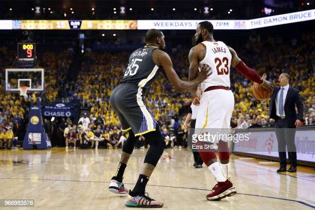 LeBron James of the Cleveland Cavaliers drives against Kevin Durant of the Golden State Warriors in Game 2 of the 2018 NBA Finals at ORACLE Arena on...
