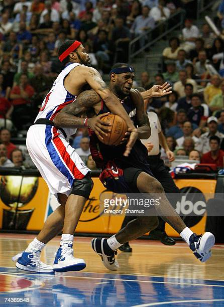 LeBron James of the Cleveland Cavaliers drives against Rasheed Wallace of the Detroit Pistons in Game Five of the Eastern Conference Finals during...