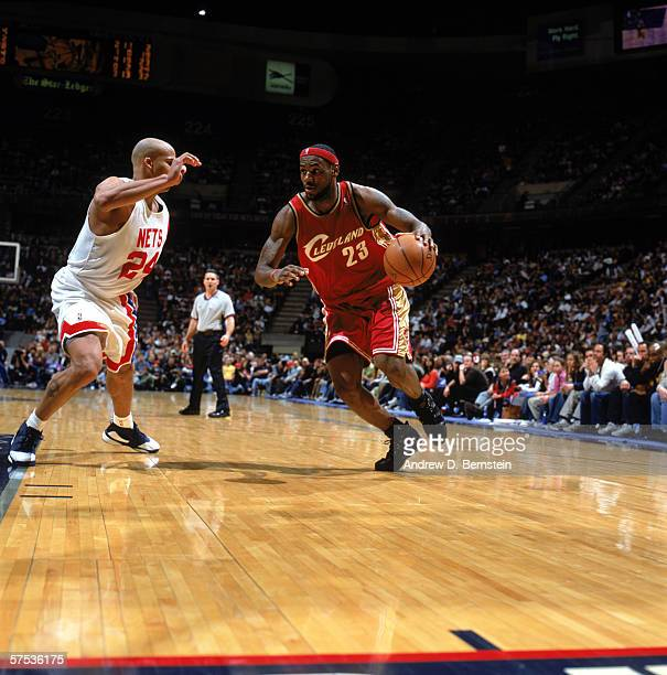 LeBron James of the Cleveland Cavaliers drives against Richard Jefferson of the New Jersey Nets during a game at Continental Airlines Arena on April...