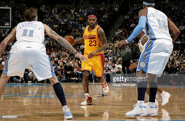 LeBron James of the Cleveland Cavaliers drives against the Denver Nuggets defense at the Pepsi Center on December 19, 2008 in Denver, Colorado. James...