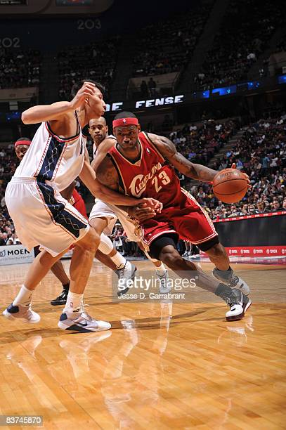 LeBron James of the Cleveland Cavaliers drives against Yi Jianlian of the New Jersey Nets during the game on November 18 2008 at the Izod Center in...