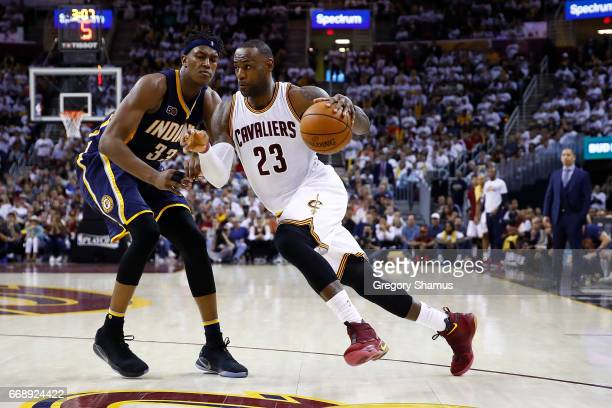 LeBron James of the Cleveland Cavaliers drives around Myles Turner of the Indiana Pacers during the second half in Game One of the Eastern Conference...