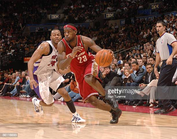 Lebron James of the Cleveland Cavaliers drives by Morris Peterson of the Toronto Raptors on November 7 2005 at the Air Canada Centre in Toronto...