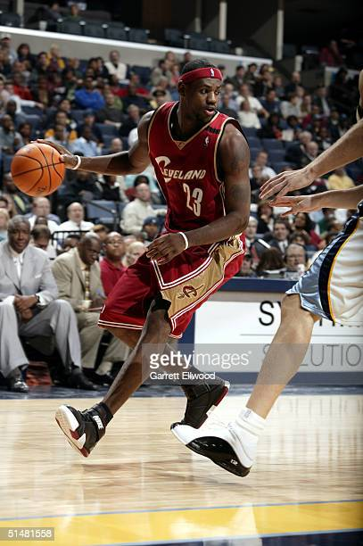 LeBron James of the Cleveland Cavaliers drives during the game against the Memphis Grizzlies on October 14 2004 at the FedEx Forum in Memphis...