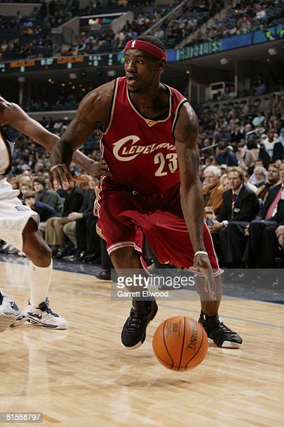 LeBron James of the Cleveland Cavaliers drives during the preseason game against the Memphis Grizzlies on October 14 2004 at FedEx Forum in Memphis...
