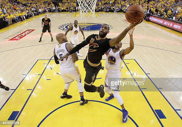 LeBron James of the Cleveland Cavaliers drives for a layup against the Golden State Warriors in Game 7 of the 2016 NBA Finals at ORACLE Arena on June...