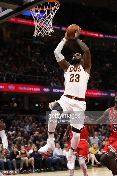 LeBron James of the Cleveland Cavaliers drives for a second half dunk while playing the Chicago Bulls during a pre season game at Quicken Loans Arena...