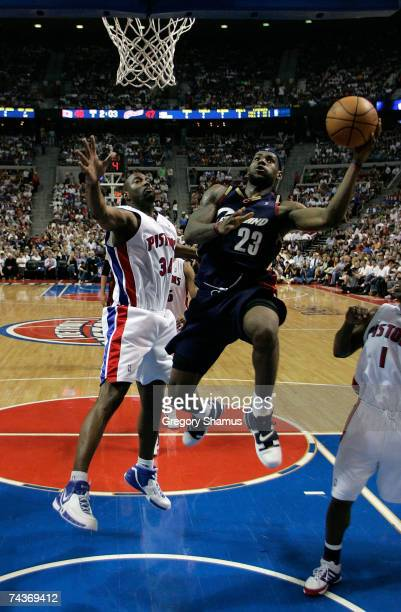 LeBron James of the Cleveland Cavaliers drives for a shot attempt against Dale Davis of the Detroit Pistons in Game Five of the Eastern Conference...